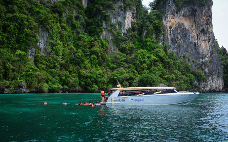 Krabi, Thailand - Jun 20, 2016. Tourists with a speedboat on the sea in Koh Phi Phi, Thailand. Phi-Phi Island is one of the most talked about places in Southeast Asia. Editorial