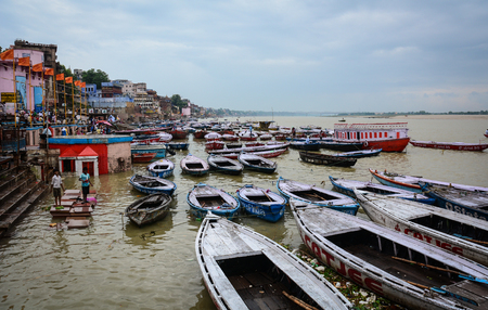 Varanasi, India - Jul 11, 2015. Wooden boats on Ganges River in Varanasi, India. Varanasi also known as Banaras or Kashi is a city on the banks of the Ganges in the Uttar Pradesh.