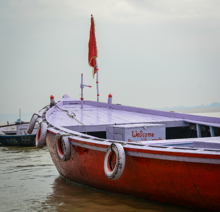 Wooden boat on the Holy Ganges River in Varanasi, India.