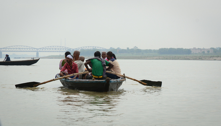 Varanasi, India - Jul 12, 2015. Tourist boat on the Ganges River in Varanasi, India. Varanasi, also known as Kashi and Benaras, is the cultural capital of India.
