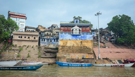 Varanasi, India - Jul 12, 2015. Landscape of the Ganges River with boats in Varanasi, India. Varanasi is one of the most fascinating places on earth, surprises abound around every corner. Editorial