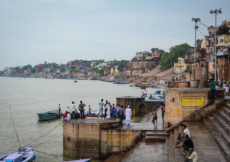 benares: Varanasi, India - Jul 11, 2015. Landscape of Ganges River at sunset in Varanasi, India. Varanasi also known as Banaras or Kashi is a city on the banks of the Ganges in the Uttar Pradesh.