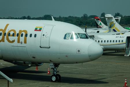 Yangon, Myanmar - Feb 27, 2016. Civil aircrafts docking at airport in Yangon, Myanmar. Yangon International Airport is the primary international airport of Myanmar (Burma).
