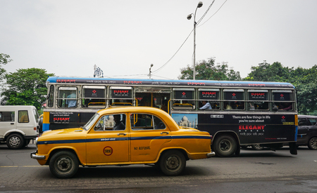 Kolkata, India - Jul 8, 2015. Vehicles run on street at downtown in Kolkata, India. Kolkata is known for its grand colonial architecture art galleries and cultural festivals. Editorial
