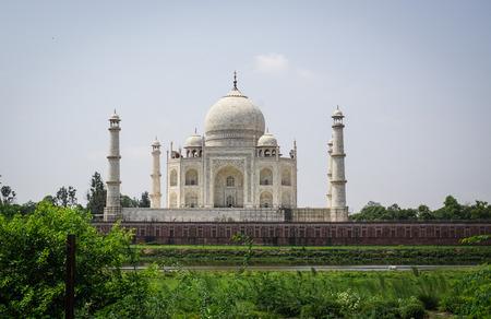 Taj Mahal at sunny day in Agra, India. Taj Mahal, the pinnacle of Mughal architecture, was built by the Mughal emperor Shah Jahan. Stock Photo