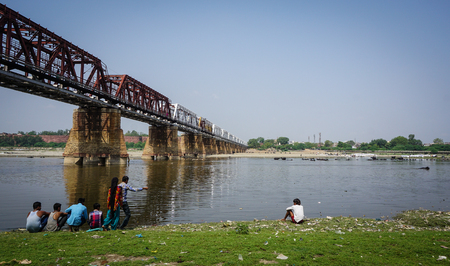 metal structure: Agra, India - Jul 13, 2015. Steel bridge with Yamuna River at sunny day in Agra, India. Agra is a city on the banks of the river Yamuna in the state of Uttar Pradesh, India.