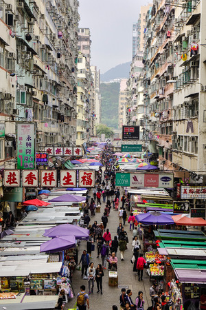 Hong Kong - Mar 29, 2017. Fa Yuen street market with many old buildings in Hong Kong. The area is popular with tourists and locals for its cheap food and fashion clothing.