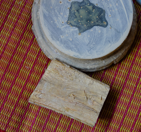 Thanaka wood and Kyauk pyin stone slab. Tanaka is Burmese tradition cosmetic made from bark of tanaka tree.