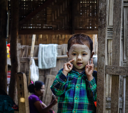 Mandalay, Myanmar - Feb 11, 2017. Portrait of a cute boy with thanaka on face in Mandalay, Myanmar. Mandalay is the second-largest city and the last royal capital of Burma. Editorial