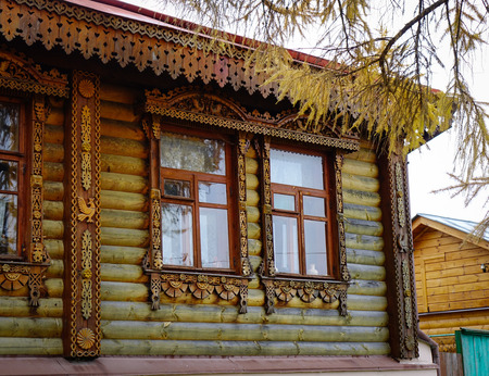 Part of wooden house with autumn trees in Suzdal Ancient Town, Russia.