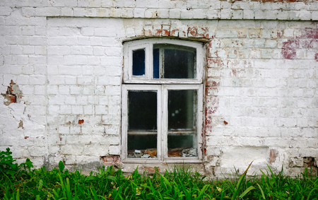 A glass window with brick wall of ancient house in Suzdal Ancient Town, Russia.