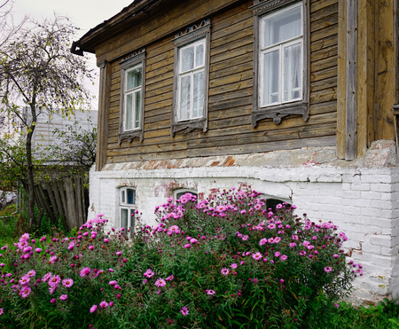 Old wooden house with small garden in Suzdal Historic Village, Russia.