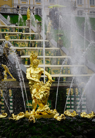 olympus: St. Petersburg, Russia - Oct 9, 2016. Fountains of Peterhof in St. Petersburg, Russia. Peterhof is a series of palaces and gardens located in Petergof, laid out on the orders of Peter the Great. Editorial