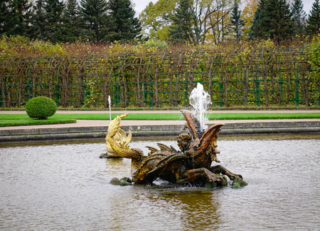 St. Petersburg, Russia - Oct 9, 2016. Fish fountains at Peterhof in St. Petersburg, Russia. The palace-ensemble along with the city center is recognized as a UNESCO World Heritage Site. Editorial