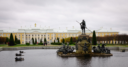 St. Petersburg, Russia - Oct 9, 2016. Poseidon Monument at Peterhof in St. Petersburg, Russia. The palace along with the city center is recognized as a UNESCO World Heritage Site. Editorial