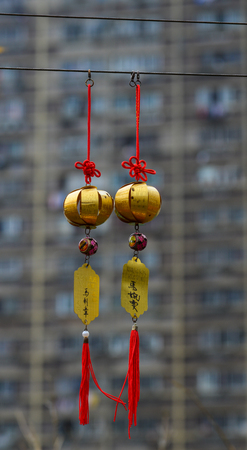 sins: Hong Kong - Mar 30, 2017. Golden lucky lanterns at Wong Tai Sin Temple in Hong Kong, China. Wong Tai Sin or Huang Daxian is a Chinese Taoist deity popular in Hong Kong.