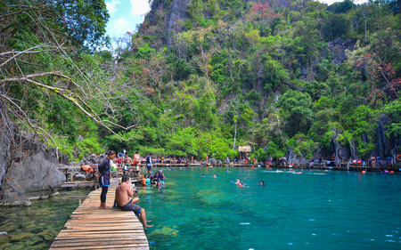 Coron, Philippines - Apr 9, 2017. Tourists enjoy on Barracuda Lake in Coron Island, Philippines. Coron is a beautiful island with trees, mangroves, white sand beach and a reef.