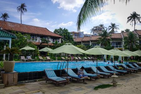 inground: Phan Thiet, Vietnam - Jun 3, 2017. Swimming pool of luxury resort in Phan Thiet, Vietnam. Phan Thiet belongs to Binh Thuan province and located 200km South of Cam Ranh Bay.