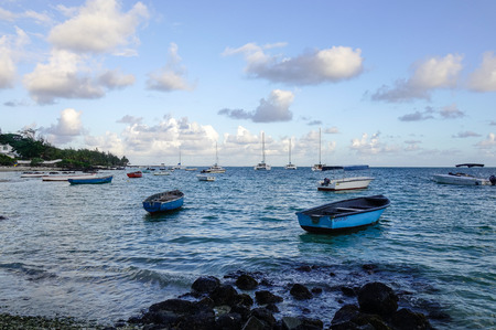 Grand Baie, Mauritius - Jan 11, 2017. Wooden boats on the sea in Grand Baie, Mauritius. Mauritius is a major tourist destination ranking 3rd in the region and 56th globally.