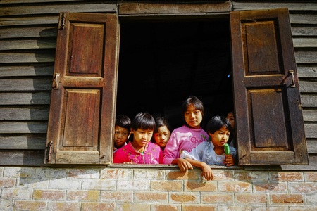 Yangon, Myanmar - Oct 17, 2015. Children playing at the poor village in Yangon, Myanmar. The total population in Myanmar was estimated at 52.9 million people in 2016. Éditoriale