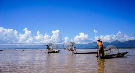 Inle, Myanmar - Oct 17, 2015. Intha people catch fish on Inle Lake, Myanmar. Inle Lake is a freshwater lake located in the Nyaungshwe Township of Shan State.