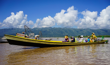 Inle, Myanmar - Oct 17, 2015. Motorboats carry tourists on Inle Lake, Myanmar. Inle Lake is a freshwater lake located in the Nyaungshwe Township of Shan State.