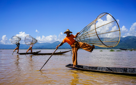 Inle, Myanmar - Oct 17, 2015. Intha people catch fish on Inle Lake, Myanmar. Inle Lake is a shallow lake in the middle of Myanmar, south-east of Mandalay.