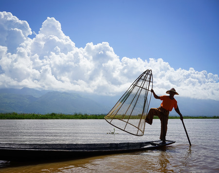 Inle, Myanmar - Oct 17, 2015. Burmese man catching fish on Inle Lake, Myanmar. Inle Lake is a freshwater lake located in the Nyaungshwe Township of Shan State.