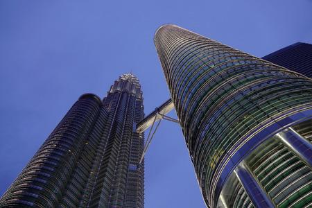 Kuala Lumpur, Malaysia - Jan 2, 2017. Petronas Twin Towers in Kuala Lumpur, Malaysia. Kuala Lumpur is a centre for finance, insurance, real estate, media and the arts of Malaysia.
