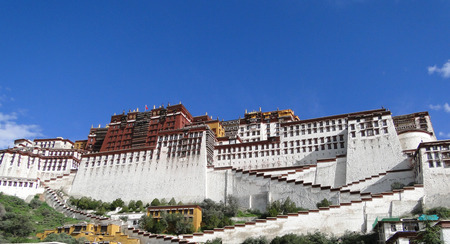 Potala Palace at sunny day in Lhasa, Tibet Region, China. Potala measures 400 metres east-west and 350 metres north-south.