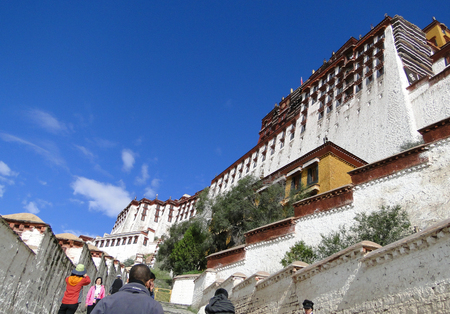 Tibet, China - Sep 6, 2010. People visit Potala Palace in Lhasa, Tibet Region, China. Potala was the residence of the Dalai Lama until the 14th Dalai Lama fled to India during the 1959.