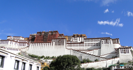 Potala Palace at sunny day in Lhasa, Tibet Region, China. Potala was the residence of the Dalai Lama until the 14th Dalai Lama fled to India during the 1959.