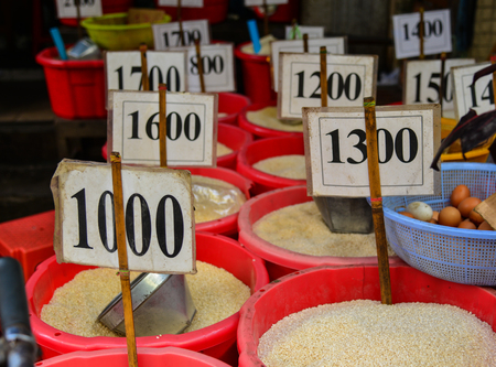 Selling rice at market in Yangon, Myanmar. Yangon is Myanmar largest city and its most important commercial centre.