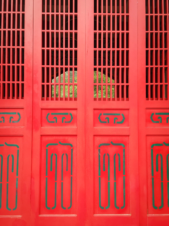 Red wooden door of ancient Buddhist pagoda in Hualien, Taiwan.