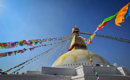 Boudhanath stupa at sunny day in Kathmandu, Nepal. Along with Swayambhu, Boudhanath is one of the most popular tourist sites in the Kathmandu area. Stock Photo