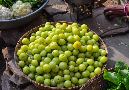 Indian gooseberry fruits at local market in Pushkar, India.