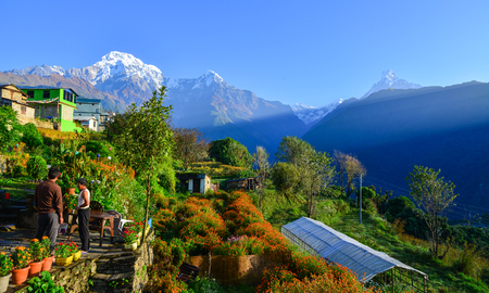 Ghandruk, Nepal - Oct 20, 2017. People at teahouse on the hill in Ghandruk, Nepal. Ghandruk is a popular place for treks in the Annapurna range of Nepal.