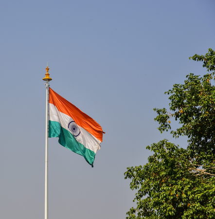 An Indian flag flying at sunny day in Jaipur, India. A parliamentary republic of India with a multi-party system, it has seven recognised national parties. 免版税图像 - 90175124