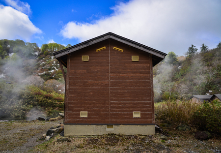 A wooden house at Tamagawa Hot Spring in Akita, Japan. Tamagawa is the highest flow rate hot spring, it has the most acidic water in Japan. 写真素材