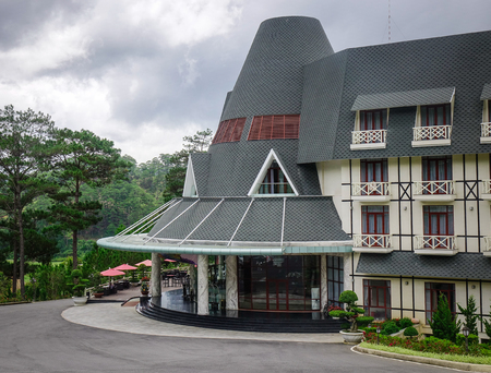 Dalat, Vietnam - Aug 17, 2017. A luxury mountain resort at rainy day in Dalat, Vietnam. The architecture of Da Lat is dominated by the style of the French colonial period.