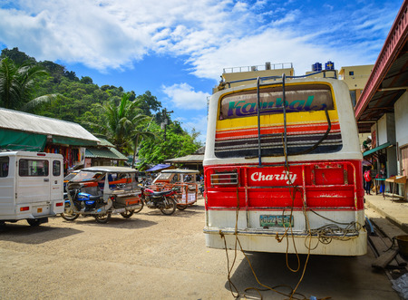 Coron, Philippines - Apr 4, 2017. A local bus parking at station in Coron Island, Philippines. Coron is the third-largest island in the Calamian Islands in northern Palawan. Stock Photo