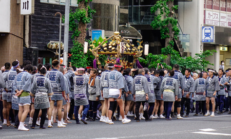 Tokyo, Japan - May 20, 2017. People at Mikoshi Matsuri Festival in Tokyo, Japan. A mikoshi is a divine palanquin (also translated as portable Shinto shrine).