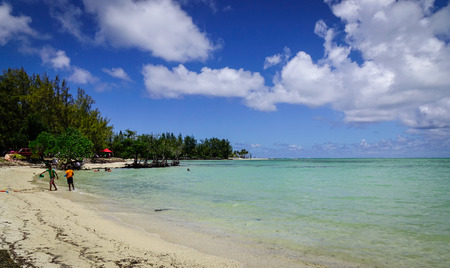 Malheureux, Mauritius - Jan 7, 2017. People enjoy on beach in Cap Malheureux, Mauritius. Mauritius is a major tourist destination, ranking 3rd in the region and 56th globally.