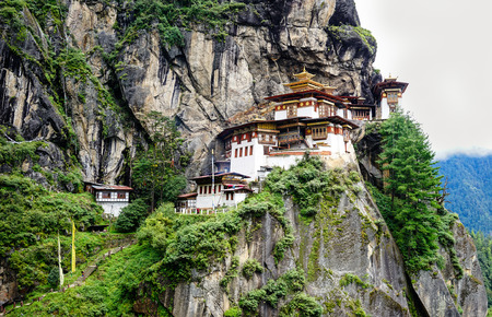 Paro Taktsang (Tiger Nest) at sunny day in Upper Paro Valley, Bhutan. Taktsang Lhakhang is Bhutan most iconic landmark and religious site. Editorial
