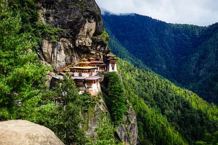 Landscape of Paro Taktsang (Tiger Nest) in Upper Paro Valley, Bhutan. Taktsang Lhakhang is Bhutan most iconic landmark and religious site. Stock Photo