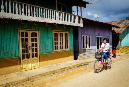 Highlands, Vietnam - Dec 5, 2015. A woman biking at mountain village in Central Highlands, Vietnam. The Highlands is a plateau bordering the lower part of Laos and Cambodia. Editorial