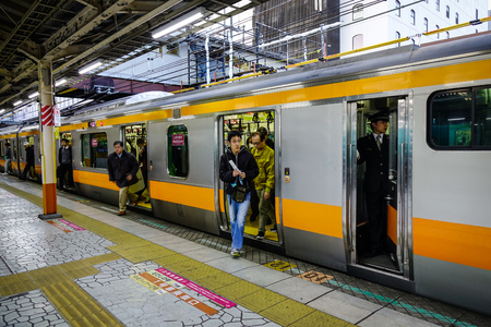 Nagoya, Japan - Dec 3, 2016. A local train stopping at the JR station in Nagoya, Japan. Nagoya is Japan fourth-largest city, and one of the nation major economic centers. Editorial