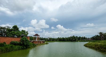 River scene with a Buddhist temple in Colombo, Sri Lanka.
