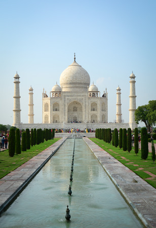 Taj Mahal at sunny day in Agra, India. The palace is an ivory-white marble mausoleum on the south bank of the Yamuna river.