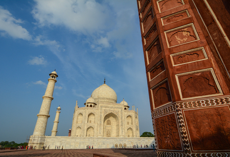 View of Taj Mahal under blue sky in Agra, India. The tomb is the centrepiece of a 17-hectare complex, which includes a mosque and a guest house.